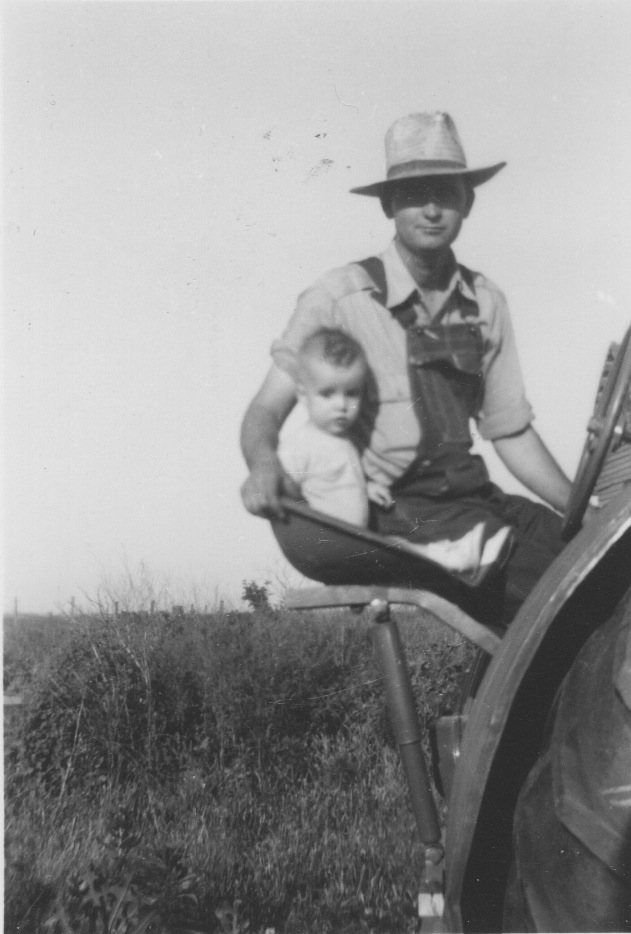 Dad and Grandpa Ivan on the tractor